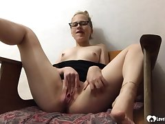 Sexy college girl with glasses fingers the brush pussy