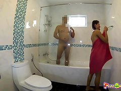 Pigtailed Thai minx takes a shower respecting her client and then fucks him good
