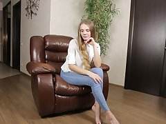 By oneself girl Elina De Leon takes off her jeans to play on a leather chair